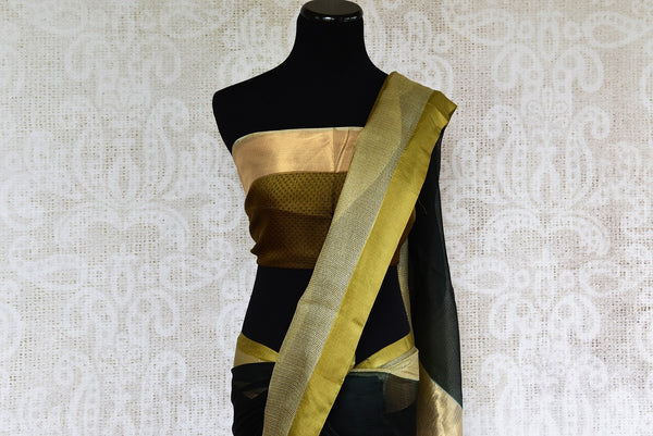 Buy black kota saree with gold borders and gold blouse piece. Perfect for any traditional occasion. Available from Pure Elegance online USA store. - top