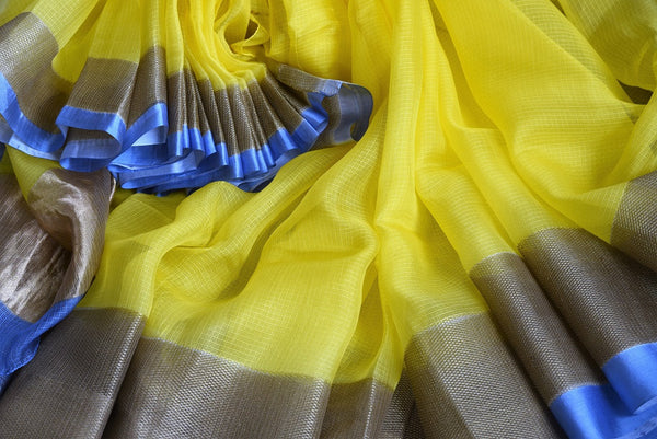 Buy this yellow zari kota sari with blue and brown borders and pallu. Comes with an elegant blue and brown blouse piece. Buy from Pure Elegance online USA store. - close up