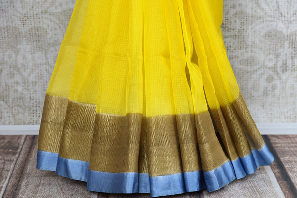 Buy this yellow zari kota sari with blue and brown borders and pallu. Comes with an elegant blue and brown blouse piece. Buy from Pure Elegance online USA store. - bottom