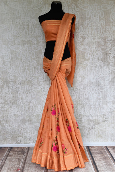 Looking for Linen Saris in USA? Buy this Orange Linen Saree online with embroidered motifs from Pure Elegance store. Pure Linen sarees online with latest Indian designs.-full view
