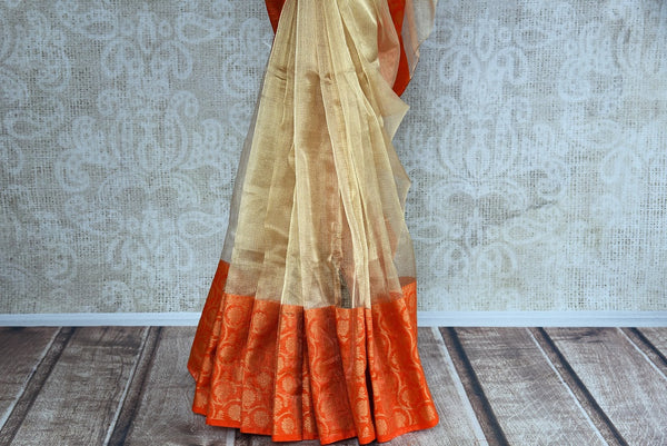 Buy gold zari Kota sari online with orange zari border. Pure Elegance brings exquisite collection of pure woven saris online and in store for Indian women in USA. -pleats