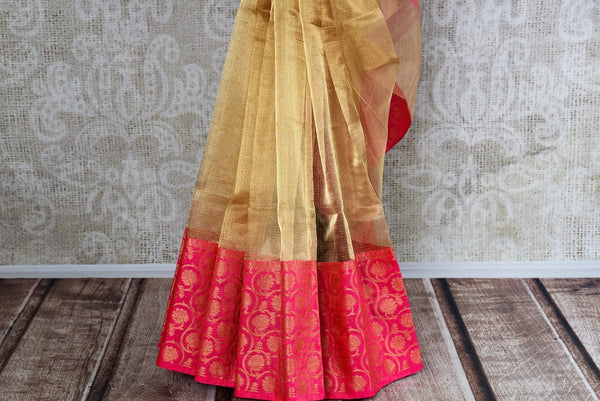 Buy gold zari Kota sari online with pink floral zari border. Pure Elegance brings elegant collection of pure woven sarees online in USA for Indian women. -pleats