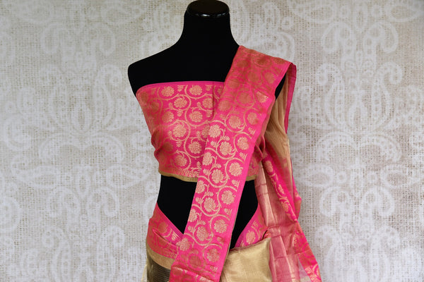 Buy gold zari Kota sari online with pink floral zari border. Pure Elegance brings elegant collection of pure woven sarees online in USA for Indian women. -pallu