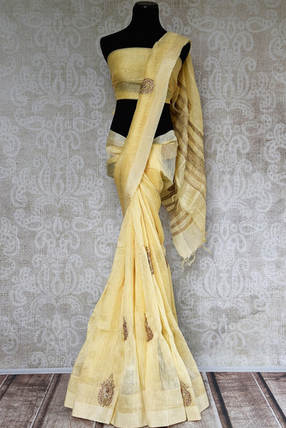 Buy elegant cream embroidered Chanderi saree online from Pure Elegance or visit our store in USA. We bring you an exquisite range of pure woven Chanderi saris perfect for summer weddings-full view
