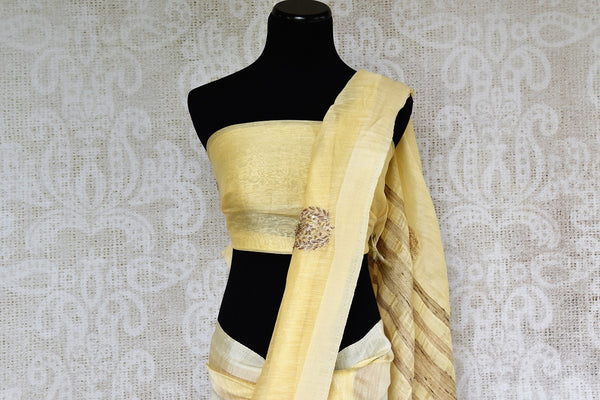 Buy elegant cream embroidered Chanderi saree online from Pure Elegance or visit our store in USA. We bring you an exquisite range of pure woven Chanderi saris perfect for summer weddings-pallu