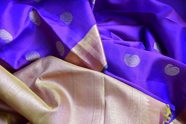Buy traditional Kanjivaram Silk Saree online in purple color from Pure Elegance store. Huge collection of exquisite Kanchipuram silk sarees online for Indian women.-details