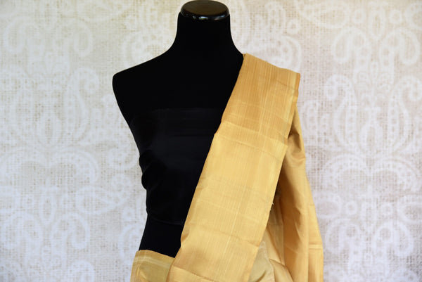 Buy beige gold Kanjivaram sari online or from Pure Elegance store in USA. We bring you beautiful range of traditional Indian Kanchipuram silk sarees online in USA.-pallu