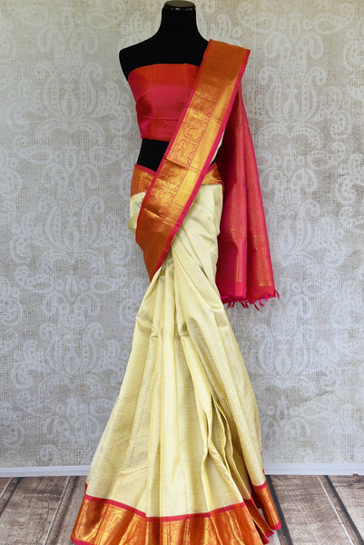 Buy this off white kanchipuram silk saree with a red and gold borders and a red pallu. Perfect for you traditional Indian wedding. Available from Pure Elegance Online USA Store. - full