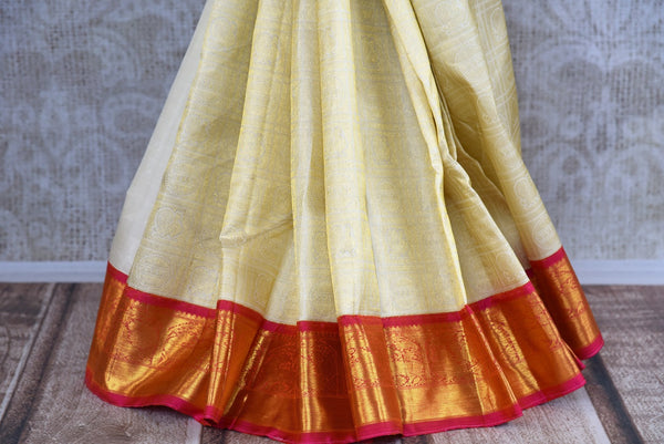 Buy this off white kanchipuram silk saree with a red and gold borders and a red pallu. Perfect for you traditional Indian wedding. Available from Pure Elegance Online USA Store. - bottom