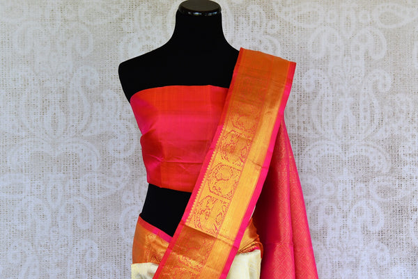 Buy this off white kanchipuram silk saree with a red and gold borders and a red pallu. Perfect for you traditional Indian wedding. Available from Pure Elegance Online USA Store. - top