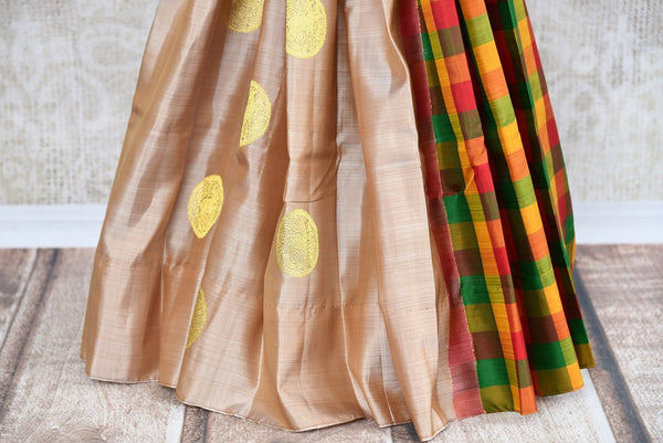 Buy Cream Kanjeevaram saree online in unique design from Pure Elegance store. Finest collection of pure woven Kanchipuram silk sarees online in USA for Indian women. -pleats