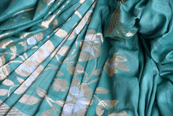 Buy Pure Elegance green khaadi banarasi silk saree with green blouse piece and floral work. Available through online USA store. - close up