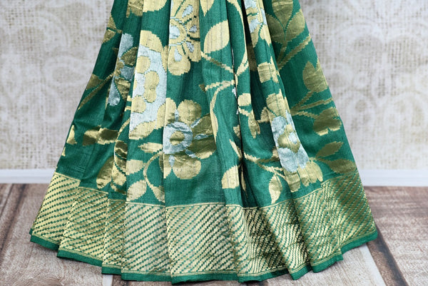 Buy Pure Elegance green khaadi banarasi silk saree with green blouse piece and floral work. Available through online USA store. - bottom