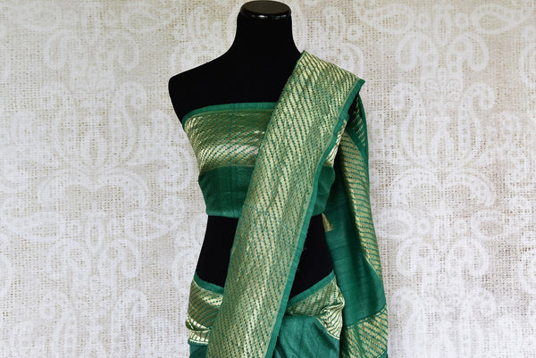 Buy Pure Elegance green khaadi banarasi silk saree with green blouse piece and floral work. Available through online USA store. - top