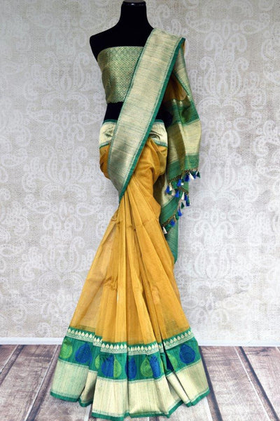 Buy yellow Tissue Banarasi saree online in USA with a green silver zari border. Pure Elegance store brings an exclusive range of woven Indian saris online in USA.-full view