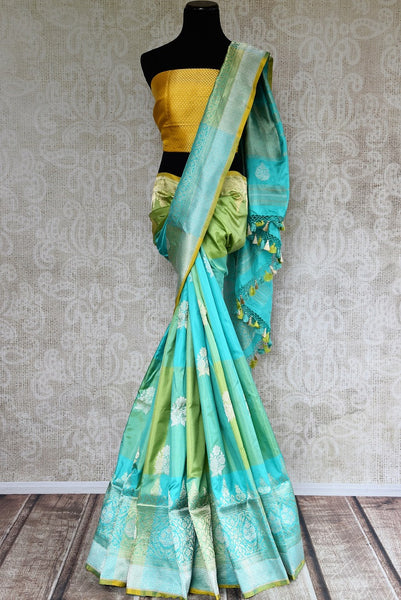 Buy blue and green Banarasi silk sari online from Pure Elegance or visit our store in USA. Choose from a range of pure woven Banarasi sarees online for Indian women.-full view