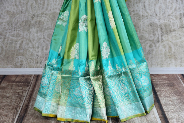 Buy blue and green Banarasi silk sari online from Pure Elegance or visit our store in USA. Choose from a range of pure woven Banarasi sarees online for Indian women.-pleats