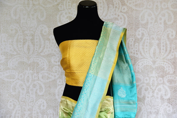 Buy blue and green Banarasi silk sari online from Pure Elegance or visit our store in USA. Choose from a range of pure woven Banarasi sarees online for Indian women.-pallu