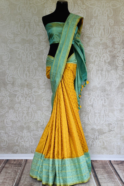 Buy Mustard Yellow Banarasi Silk Saree online with Zari border and buta from Pure Elegance store. Exclusive collection of pure woven Banarasi Sarees for Indian women.-full view