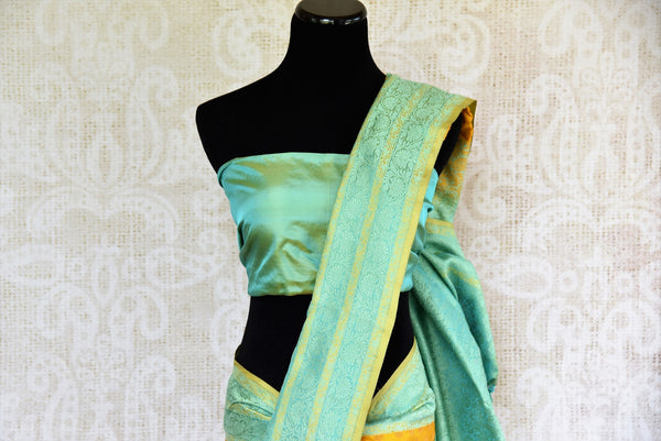 Buy Mustard Yellow Banarasi Silk Saree online with Zari border and buta from Pure Elegance store. Exclusive collection of pure woven Banarasi Sarees for Indian women.-pallu