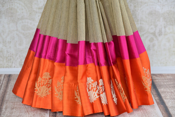 Stylish Cotton Banarasi Saree online in brown color with a satin border and zari buta. Choose from Pure Elegance Stylish Cotton Sarees, Banarasi sarees in USA. -pleats