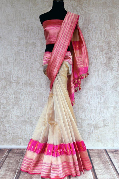 Buy cream gold tissue Banarasi saree online in USA with a pink zari border. Pure Elegance store brings an exclusive range of Indian Banarasi sarees online in USA.-full view