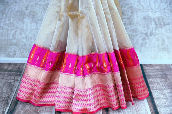 Buy cream gold tissue Banarasi saree online in USA with a pink zari border. Pure Elegance store brings an exclusive range of Indian Banarasi sarees online in USA.-pleats