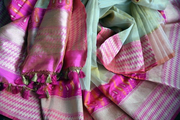 Buy cream gold tissue Banarasi saree online in USA with a pink zari border. Pure Elegance store brings an exclusive range of Indian Banarasi sarees online in USA.-details