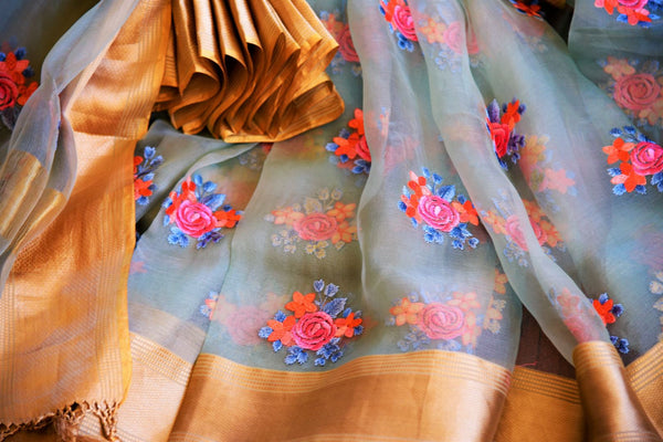 Buy elegant blue tissue Organza saree online in USA with embroidery from Pure Elegance. Our store has an exquisite range of woven Indian sarees online for women.-details