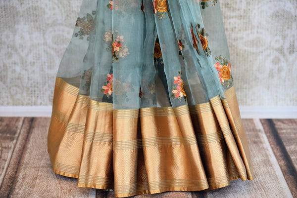 Buy Blue Organza Saree online with floral embroidery from Pure Elegance store. Exquisite collection of Organza Sarees, woven Indian Sarees online in USA for every occasion.-pleats