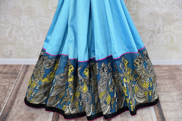 Buy blue hand printed raw silk Kalamkari saree online with a readymade blouse from Pure Elegance or visit our store in USA. Shop Indian Kalamkari saris online in USA.-pleats