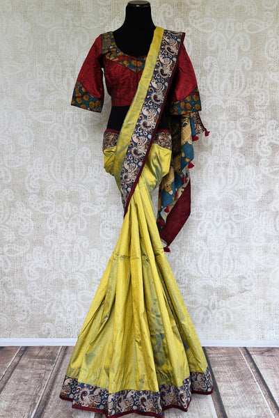 Buy yellow hand printed Kalamkari sari online with a readymade blouse from Pure Elegance or visit our store in USA. Shop Indian Kalamkari sarees online in USA.-full view