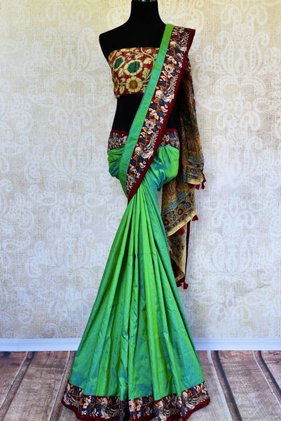 Buy green raw silk saree with Kalamkari border online in USA. Pure Elegance clothing store brings an exquisite range of ethnic Indian Kalamkari sarees in USA. Shop online.-full view