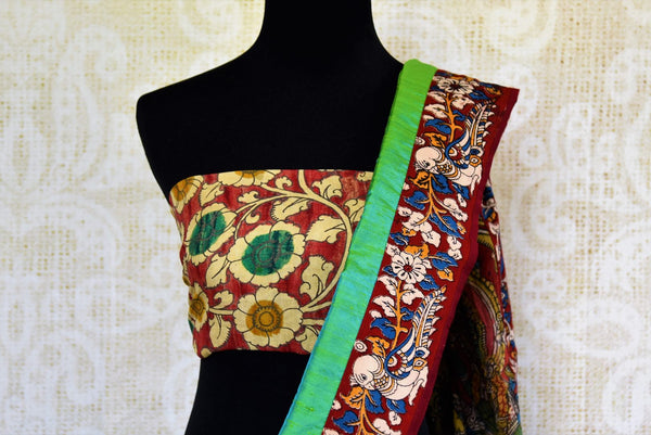 Buy green raw silk saree with Kalamkari border online in USA. Pure Elegance clothing store brings an exquisite range of ethnic Indian Kalamkari sarees in USA. Shop online.-blouse pallu