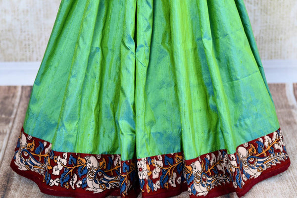 Buy green raw silk saree with Kalamkari border online in USA. Pure Elegance clothing store brings an exquisite range of ethnic Indian Kalamkari sarees in USA. Shop online.-pleats