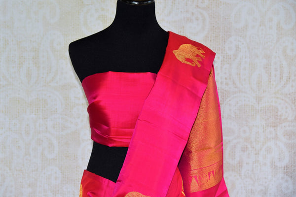 Pure Elegance store brings woven Indian Kanchipuram sarees online in USA for weddings. Buy pink pure Kanjeevaram silk saree online with gold zari elephant butas. -pallu