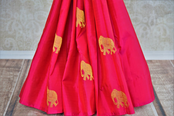 Pure Elegance store brings woven Indian Kanchipuram sarees online in USA for weddings. Buy pink pure Kanjeevaram silk saree online with gold zari elephant butas. -pleats