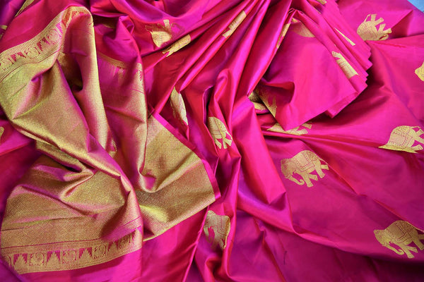 Pure Elegance store brings woven Indian Kanchipuram sarees online in USA for weddings. Buy pink pure Kanjeevaram silk saree online with gold zari elephant butas. -details
