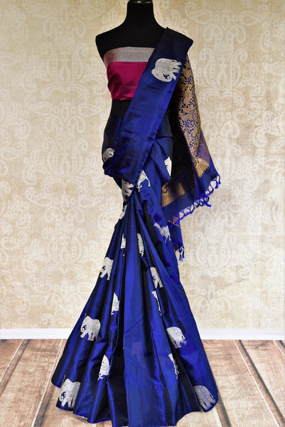 Pure Elegance store brings woven  Indian Kanjivaram sarees online in USA for weddings. Buy navy blue and magenta Kanjeevaram silk saree online with zari butas. -full view