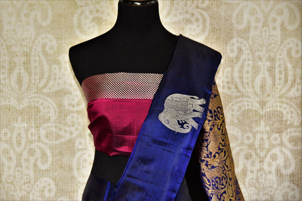 Pure Elegance store brings woven  Indian Kanjivaram sarees online in USA for weddings. Buy navy blue and magenta Kanjeevaram silk saree online with zari butas. -pleats