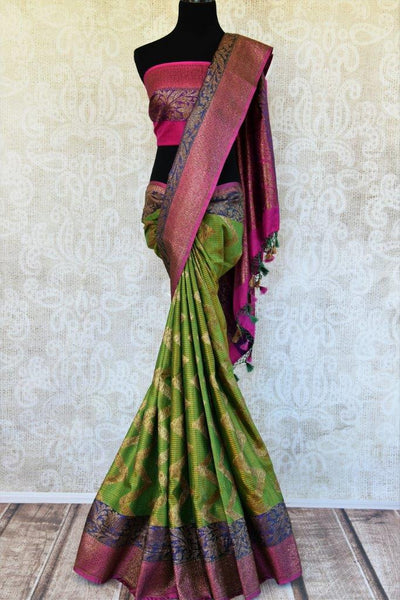 Buy green tassar Banarasi saree online from Pure Elegance with pink and purple border. Our store in USA brings exquisite woven Indian Banarasi saris online for women.-full view