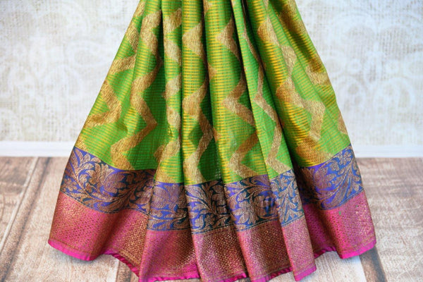 Buy green tassar Banarasi saree online from Pure Elegance with pink and purple border. Our store in USA brings exquisite woven Indian Banarasi saris online for women.-pleats