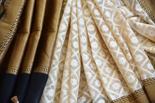 Pure Elegance presents beautiful woven Tissue Banarasi sarees online in USA.  Buy classic off white Indian Tissue Banarasi saree online with black zari border.-details