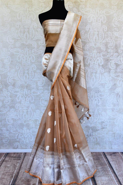 Pure Elegance presents beautiful woven Indian Banarasi sarees online in USA.  Buy brown Tissue Banarasi sari online with gold orange zari border and pallu. Shop now.-full view