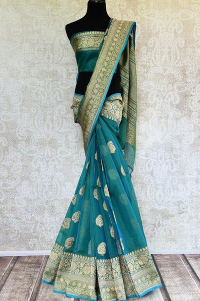 Pure Elegance presents traditional pure woven Indian Banarasi sarees online in USA.  Buy greenish blue Tissue Banarasi sari online with gold zari border and buta.-full view
