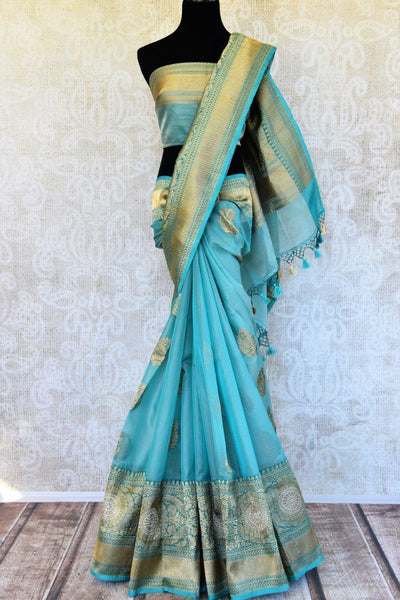Pure Elegance presents traditional woven Indian Banarasi sarees online in USA.  Buy turquoise blue Tissue Banarasi sari online with gold zari border and buta.-full view
