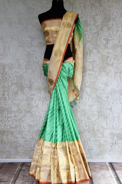 Buy green striped Banarasi silk saree online with gold tissue border. Pure Elegance store presents exquisite range of designer Indian sarees online for women in USA.-full view