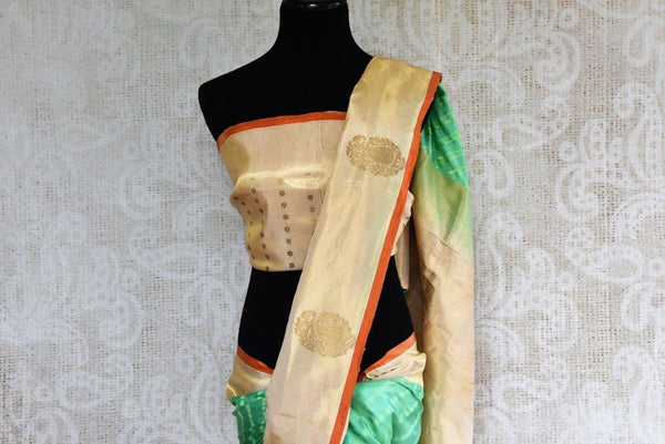 Buy green striped Banarasi silk saree online with gold tissue border. Pure Elegance store presents exquisite range of designer Indian sarees online for women in USA.-pallu