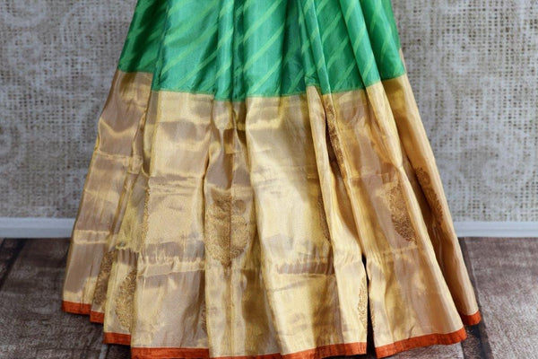 Buy green striped Banarasi silk saree online with gold tissue border. Pure Elegance store presents exquisite range of designer Indian sarees online for women in USA.-pleats