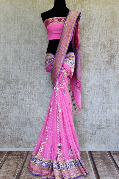Buy pink Georgette Banarasi saree online in USA with zari border and floral buta. Pure Elegance store brings you woven Indian designer georgette saris online in USA.-full view